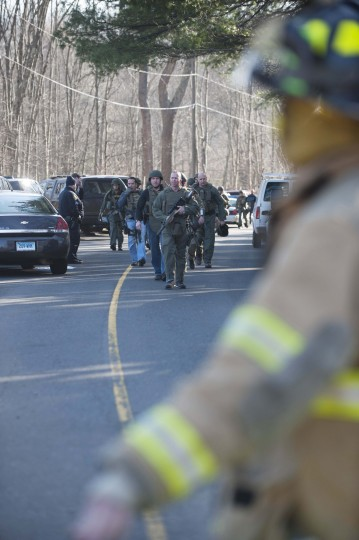Connecticut State Police walk on Dickson Street from the scene of an elementary school shooting in Newtown, Connecticut. According to reports, there are about 27 dead, 18 children, after a gunman opened fire in at the Sandy Hook Elementary School. The shooter was also killed. (Douglas Healey/Getty Images)