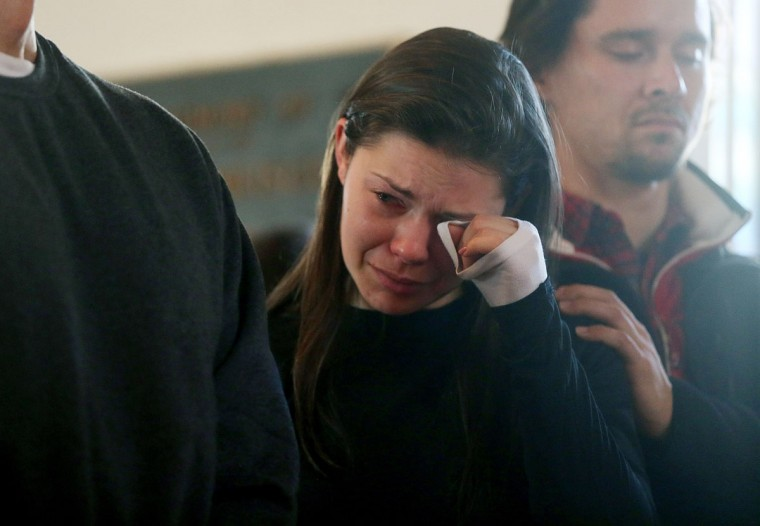 A woman wipes tears from her eyes at a prayer service held to reflect on the violence at Sandy Hook Elementary School in Newtown, Connecticut. At least 26 people were shot dead, including 20 children, after a gunman opened fire in the school. (Mario Tama/Getty Images)