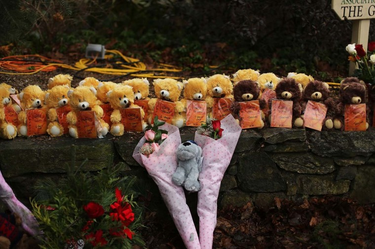 Teddy bears and flowers, in memory of those killed, are left at a memorial down the street from the Sandy Hook School December 16, 2012 in Newtown, Connecticut. (Spencer Platt/Getty Images)