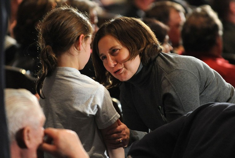 A woman speaks to a young girl before U.S. President Barack Obama speaks at an interfaith vigil for the shooting victims from Sandy Hook Elementary School on December 16, 2012 at Newtown High School in Newtown, Connecticut. Twenty-six people were shot dead, including twenty children, after a gunman identified as Adam Lanza opened fire at Sandy Hook Elementary School. Lanza also reportedly had committed suicide at the scene. A 28th person, believed to be Nancy Lanza, found dead in a house in town, was also believed to have been shot by Adam Lanza. (Olivier Douliery-Pool/Getty Images)