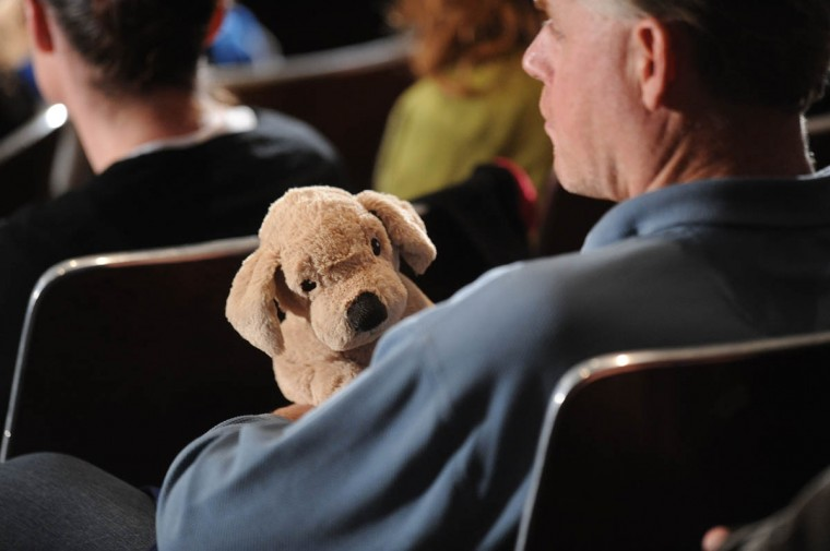 A man holds a stuffed dog before U.S. President Barack Obama speaks at an interfaith vigil for the shooting victims from Sandy Hook Elementary School on December 16, 2012 at Newtown High School in Newtown, Connecticut. Twenty-six people were shot dead, including twenty children, after a gunman identified as Adam Lanza opened fire at Sandy Hook Elementary School. Lanza also reportedly had committed suicide at the scene. A 28th person, believed to be Nancy Lanza, found dead in a house in town, was also believed to have been shot by Adam Lanza. (Olivier Douliery-Pool/Getty Images)