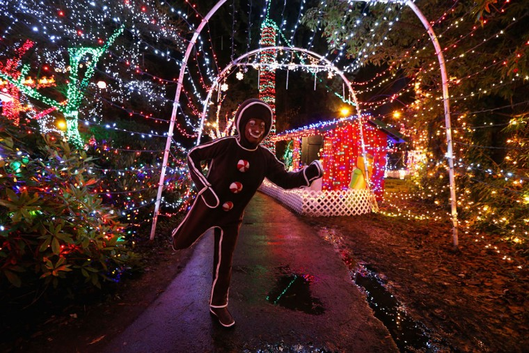 "A person dressed as a gingerbread man is seen during the ""Bright Lights Stanley Park"" display at Stanley Park in Vancouver, Canada. Over one million lights are strung up in the forest for the annual Christmas event, which runs through January 1st, 2013. (Cameron Spencer/Getty Images)"