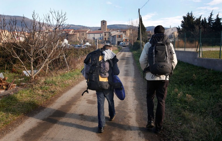 Backpackers arrive in Bugarach, a small French village in the foothills of the Pyrenees that some claim to be one of the few places on Earth that will be spared when the world ends on December 21, 2012. Miviludes, the French government's dedicated sect watchdog, are investigating the likelihood of apocalyptic sect activity or ritualized suicides due to the rumored prophecy of the ancient Mayan calendar. (Patrick Aventurier/Getty Images)