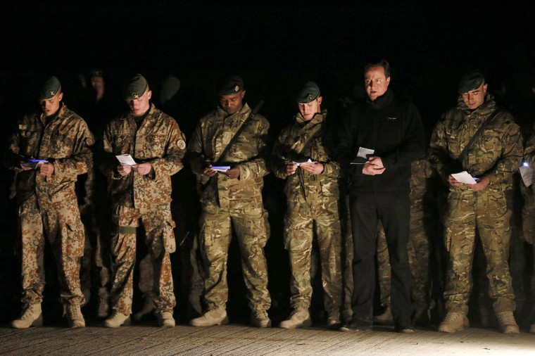 British Prime Minister David Cameron (second from right) attends a carol service with British, Danish and Bosnian soldiers on December 20, 2012 in Helmand Province, Afghanistan. Cameron made a Christmas visit to British troops in the region amid tight security. (Stefan Wermuth - WPA Pool/Getty Images)