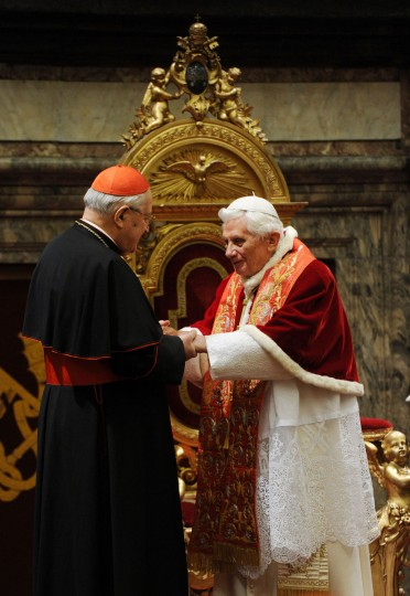 Pope Benedict XVI receives the Roman Curia for the annual Christmas greetings at the Clementina Hall on December 21, 2012 in Vatican City, Vatican. (Eric Vandeville/Vatican Pool via Getty Images)