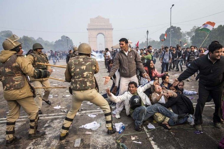 Delhi police lathi charge to disperse protestors during a protest against the Indian governments reaction to recent rape incidents in India, in front of India Gate on December 23, 2012 in New Delhi, India. The gang rape of a 23-year-old paramedical student in a moving bus on December 16, in Delhi, has led to people to react openly against the governments current rape laws. (Daniel Berehulak/Getty Images)