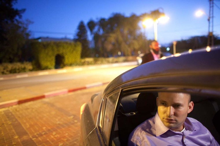 Naftali Bennett Head of HaBayit HaYehudi Party, the Jewish Home party, sits in his car during a campaign tour on December 26, 2012 in Tel Aviv, Israel. The religious Jewish Home party (HaBayit HaYehudi) led by Naftali Bennett, are mounting a strong challenge for the right wing vote from Benjamin Netanyahu's Likud party as Israel heads for a general election on January 22. (Uriel Sinai/Getty Images)