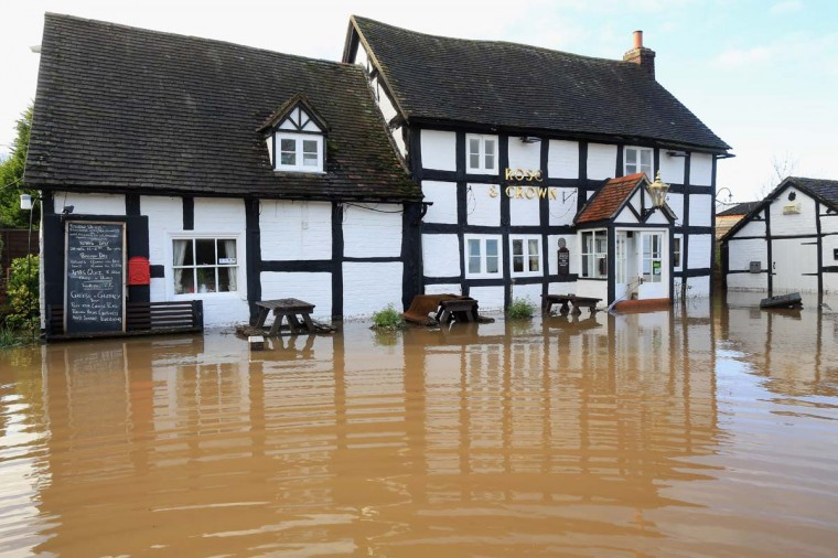 The Rose and Crown public house suffers flooding in the village of Severn Stoke near Worcester on December 27, 2012 in Worcester, England. 2012 could be the UK's wettest year on record according to forecasters and there are currently 88 flood warnings and 207 flood alerts in England and Wales. (Christopher Furlong/Getty Images)
