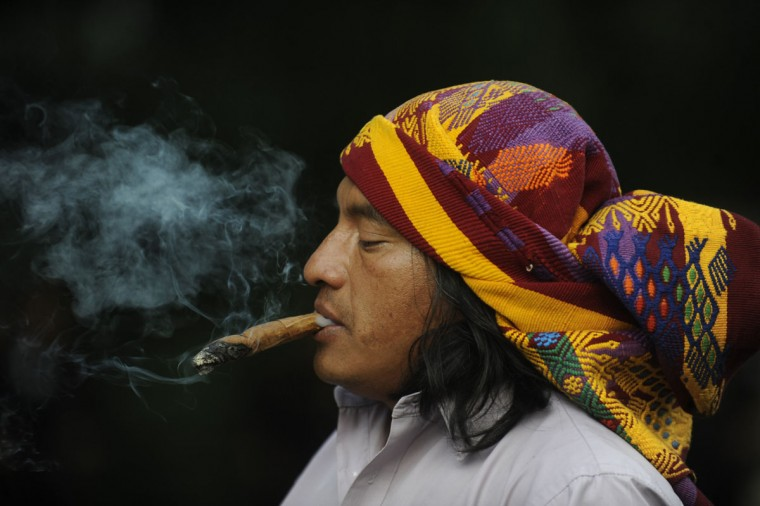 "A Mayan shaman performs a ritual at the Quirigua archaeological site, 210 km north of Guatemala City, where ceremonies will be held to celebrate the end of the Mayan calendar and start of a new era on December 21. The Mayan calendar has 18 months of 20 days each plus a sacred month, ""Wayeb,"" with five days. ""B'aktun"" is the largest unit in the time-cycle system, and is about 400 years. The broader era spans 13 B'aktun, or about 5,200 years. (Johan Ordonez/AFP/Getty Images)"