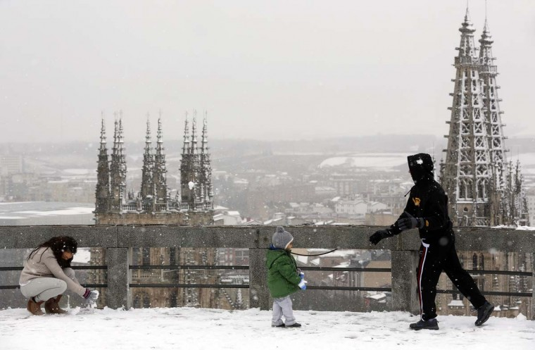 People play with snow in Burgos, northern Spain, during the first snowfall of the season on November 28, 2012. (Cesar Manso/AFP/Getty Images)