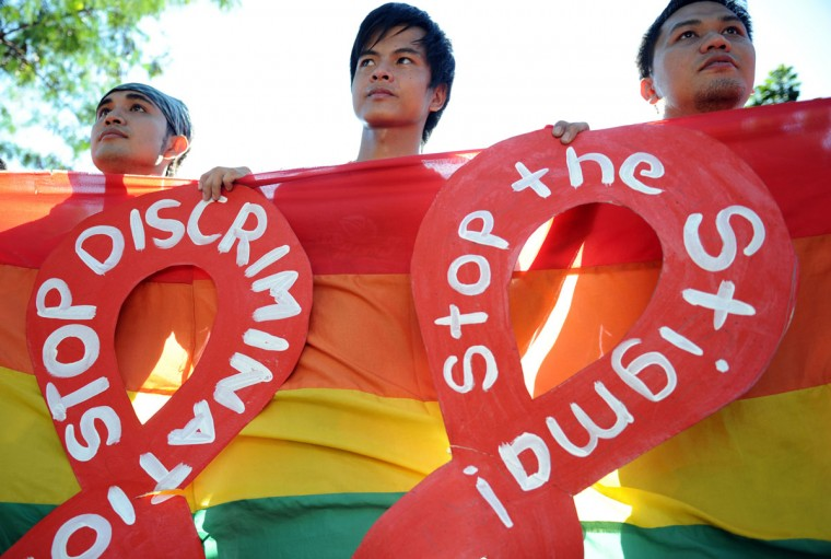 AIDS activists carry placards during a protest march marking World AIDS Day in Manila, the capital of the Philippines, on December 1, 2012. Discrimination against homosexuals and people infected with HIV is contributing to the rapid rise of the incurable disease in the nation, officials and health activists said. (Ted Aljibe/AFP/Getty Images)