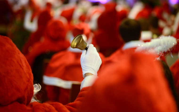 A man dressed as Santa Claus rings a bell as he attends the annual meeting of volunteer Santa Clauses and Angels on December 1, 2012 in Berlin. The event was organized by Studentenwerk Berlin, a student organization at the German capital's technical university (Technische Universitaet Berlin), that sends out its students dressed as Santas and angels every year to visit company parties in December and families on Christmas Eve. (Johannes Eisele/AFP/Getty Images)
