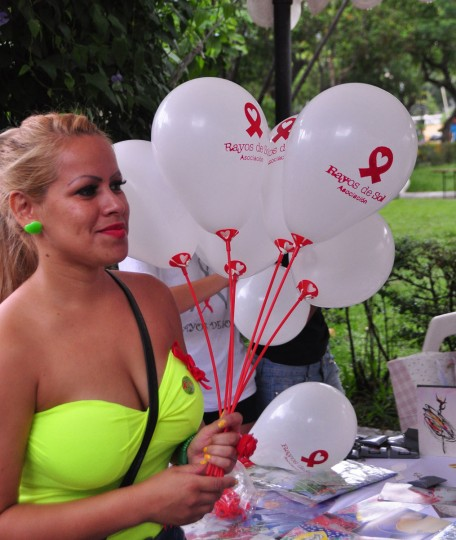 A woman gives out balloons during an event held on World AIDS Day, in Asuncion, Paraguay, on December 1, 2012. (Norberto Duarte/AFP/Getty Images)