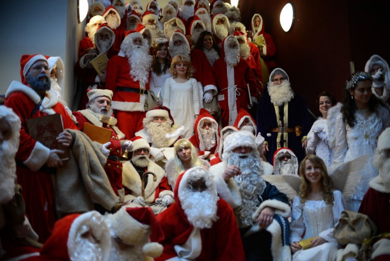 Women dressed as angels and men dressed as Santa Claus attend the annual meeting of volunteer Santa Clauses and Angels on December 1, 2012 in Berlin. The event was organized by Studentenwerk Berlin, a student organization at the German capital's technical university (Technische Universitaet Berlin), that sends out its students dressed as Santas and angels every year to visit company parties in December and families on Christmas Eve. (Johannes Eisele/AFP/Getty Images)