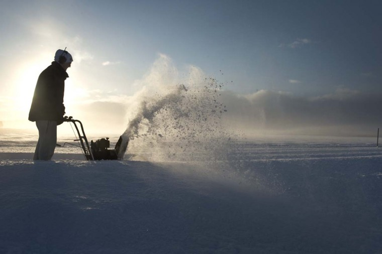 A man uses a snow blower to clear a small road leading to his farm in Saleby, outside Skara in southwestern Sweden on December 1, 2012. The Swedish Transport Administration had difficulties clearing all roads and had to focus on main roads after an unusually heavy snowfall in the area. (Bjorn Larsson/AFP/Getty Images)