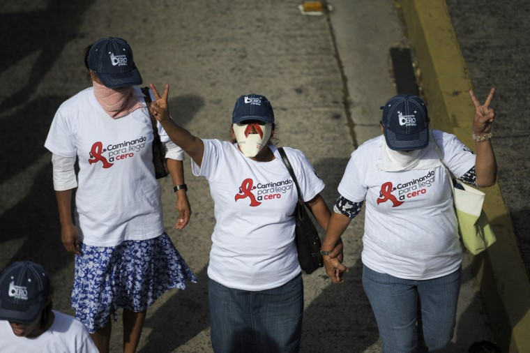 Activists participate in a march to commemorate World AIDS Day, in San Salvador, El Salvador, on December 1, 2012. (Jose Cabezas/AFP/Getty Images)