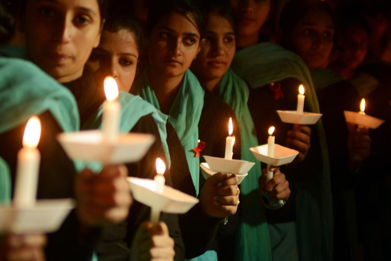 Indian nursing students hold a candlelight vigil in Amritsar to commemorate World AIDS Day on December 1, 2012. The UNAIDS agency says some 2.5 million Indians are living with HIV, with many of them ostracized by their communities.(Narinder Nanu/AFP/Getty Images)