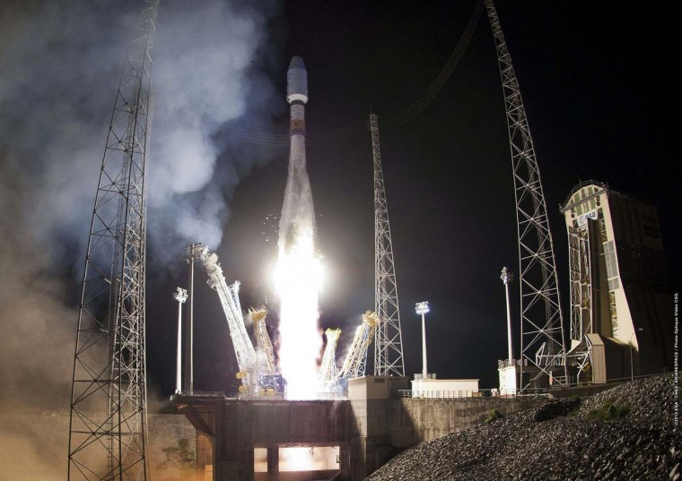 A Soyuz rocket lifts off from a base in Kourou, French Guiana, on December 2, 2012. The Soyuz rocket was carrying the 2nd satellite for the Pleiades earth observation system developed by the CNES (National Centre for Space Studies), the French government's space agency. (JM Guillon/AFP/Getty Images)