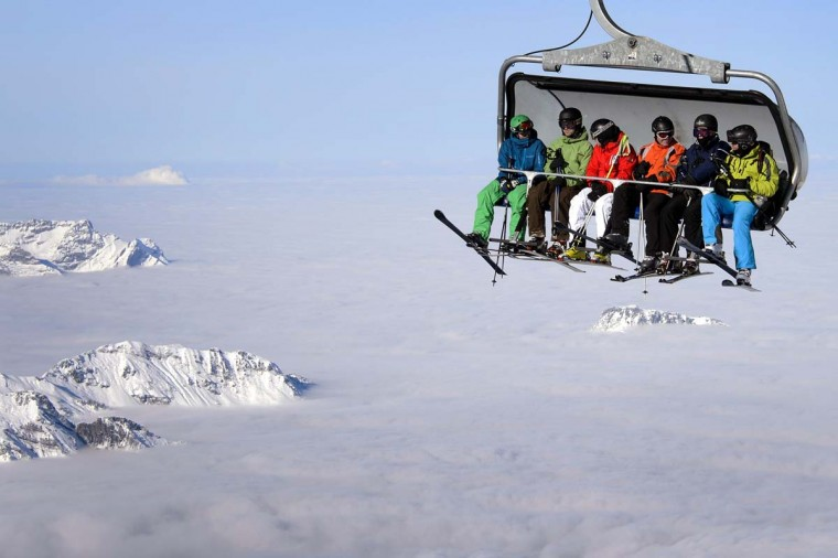 Skiers are seen on a cable car above the fog on December 1, 2012 in the Titlis mountain above Engelberg, Central Switzerland. (Fabrice Coffrini/AFP/Getty Images)