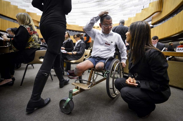 Victim of a landmine, Cambodian Tun Chan Nareth (C) gestures at the opening of the 12th assembly of countries party to the International Ottawa Treaty banning the use of landmines on December 3, 2012 at the United Nations offices in Geneva. (Fabrice Coffrini/AFP/Getty Images)