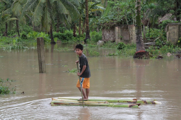 A boy rides on a makeshift raft made from banana tree as he makes his way through their flooded home after heavy rans and strong winds brought about by Typhoon Bophal hit Pantukan town, Compostela Valley province in southern island of Mindanao. Typhoon Bopha smashed into the southern Philippines early December 4, as more than 40,000 people crammed into shelters to escape the onslaught of the strongest cyclone to hit the country this year. (STR/AFP/Getty Images