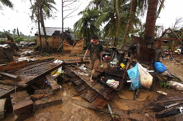 Residents walk amongst their destroyed houses after Typhoon Bopha hit Compostela town, Compostela Valley province, in southern Philippine island of Mindanao. (Karlos Manlupig/AFP/Getty Images