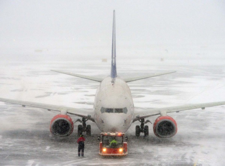 A Boeing 737-600 from Scandinavian Airlines, SAS, is parked at terminal 5 at Arland airport outside Stockholm, on December 5, 2012. Only one track is open due to a heavy snow fall and many flights have ben cancelled. (Johan Nilsson/AFP/Getty Images)