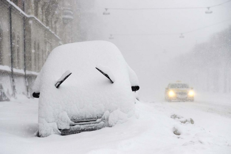 A parked car seen covered with snow during a blizzard in Stockholm, Sweden on December 5, 2012. (Jonathan Nakstrand/AFP/Getty Images)