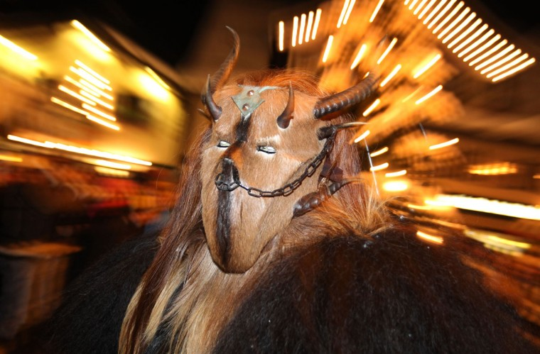 "People dressed as animals with masks with horns for the so-called ""Klausentreiben"" make their way through the southern German city of Sonthofen on December 5, 2012 during a traditional pre-Christmas parade. (Karl-Josef Hildenbrand/AFP/Getty Images)"