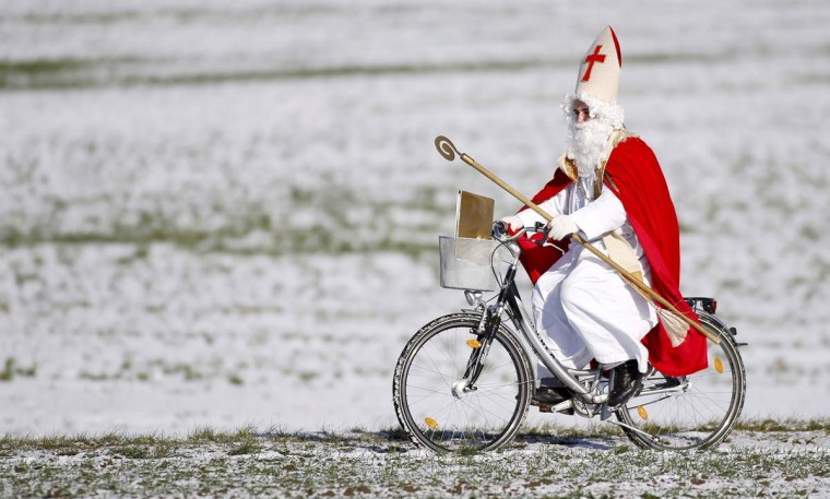 A man dressed as Santa Claus rides his bike in Offingen, southern Germany. December 6 is the traditional day of Santa Claus in Germany. (Thomas Warnack/Getty Images)