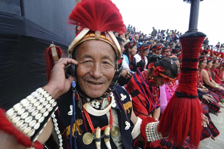 AN Indian Naga tribesman talks on his mobile phone during the Hornbill Festival at Kisama, some 15 kms from Kohima, India's Nagaland state. The week long Hornbill Festival of Nagaland, which celebrates the cultural heritage of the sixteen Naga tribes, runs annually from December 1-7. (Biju Boro/Getty Images)
