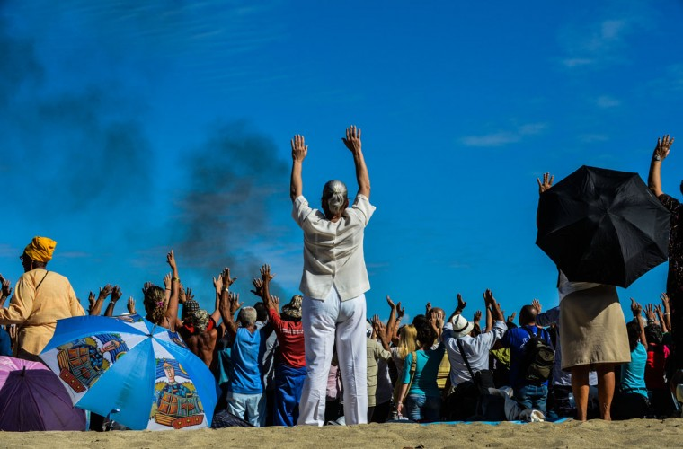 Cubans participate in a Mayan ritual at Bacuranao beach in eastern Havana, Cuba, on Dec. 6, 2012. Mayan leaders were in Cuba for a conference, delivering speeches and conducting ceremonies to prepare for the beginning of a new era. (Alberto Roque/AFP/Getty Images)