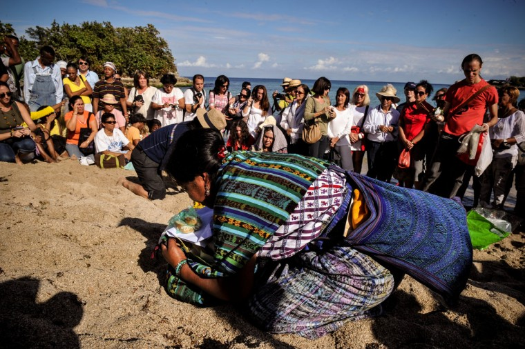 Mayan leaders take part in a ritual at Bacuranao beach in eastern Havana, Cuba, on Dec. 6, 2012. Mayan leaders were in Cuba for a conference, delivering speeches and conducting ceremonies to prepare for the beginning of a new era. (Alberto Roque/AFP/Getty Images)