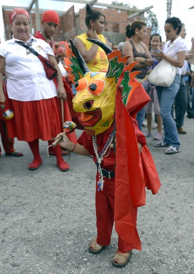 A young member of the Dancing Devils performs during a demonstration in the Venezuelan village of Yare, Miranda State. On December 6, the UNESCO declared the Dancing Devils as an Intangible Cultural Heritage of Humanity. Every Corpus Christi day, the Dancing Devils, in colourful costumes and wearing grotesque masks, perform their ritual during the Dancing Devils of Yare folkloric festivity. (Juan Barreto/AFP/Getty Images)