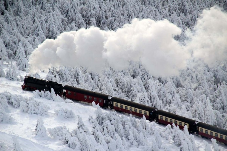 A train of the Brocken Railway steams through the winter landscape with snow covered pine trees on Brocken Mountain in Harz, eastern Germany, on December 8, 2012. (Stefan Rampfel/AFP/Getty Images)