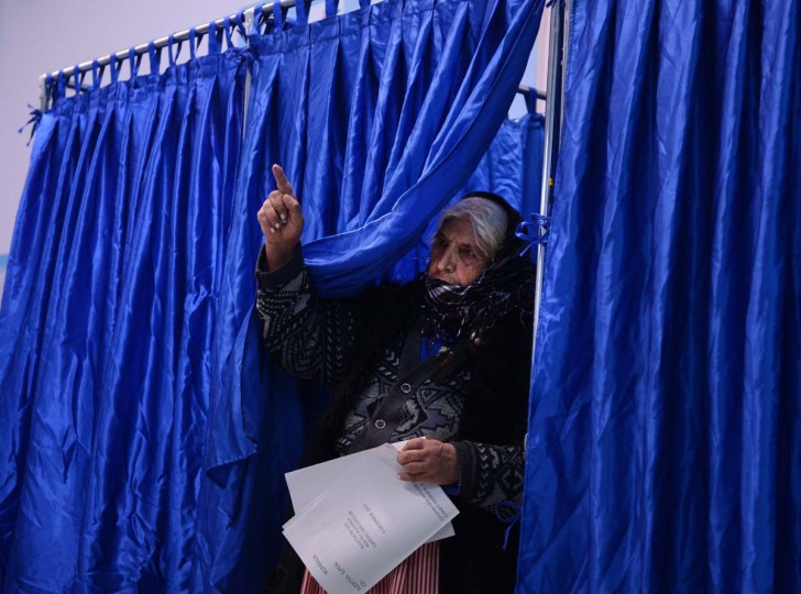 A Romanian Roma woman exits a vote cabin at a polling station in Pantelimon village, near Bucharest, on December 9, 2012 as Romanians head to the polls to elect a new parliament. (Daniel Mihailescu/AFP/Getty Images)