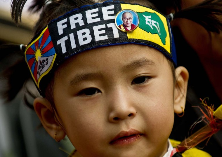 A Tibetan child is pictured with a Free Tiet bandana as Tibetan activists in-exile take part in a protest in New Delhi on December 10, 2012 to mark World Human Rights Day. A 16-year-old Tibetan girl has died after setting herself on fire, Chinese state media said December 10, in an area that has become a flashpoint for protests against Beijing's rule. (Manan Vatsyayanamanan/AFP/Getty Images)