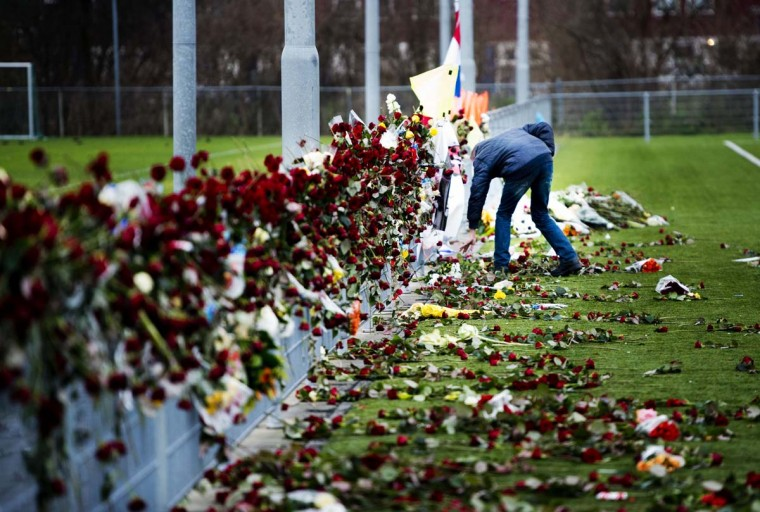 Some hours before the cremation of Dutch linesman Richard Nieuwenhuizen, a man looks at the flowers at his memorial site by the clubhouse of Dutch soccer club SC Buitenboys in Almere, Netherlands, on December 10, 2012. The linesman of the club SC Buitenboys in Almere died on 3 December after he was allegedly beaten by teenage players of SV Nieuw Sloten following a match on December 2. (Robin Utrecht/AFP/Getty Images)