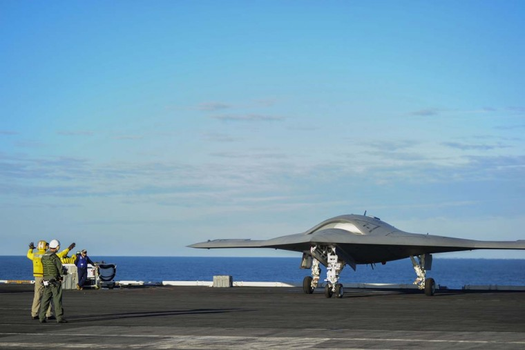This U.S. Navy handout photo released December 10, 2012 shows the X-47B Unmanned Combat Air System (UCAS) demonstrator as it taxies on the flight deck of the aircraft carrier USS Harry S. Truman (CVN 75) in the Atlantic Ocean. Harry S. Truman is the first aircraft carrier to host test operations for an unmanned aircraft. Picture taken on December 9, 2012. (Kristina Young/AFP/Getty Images)