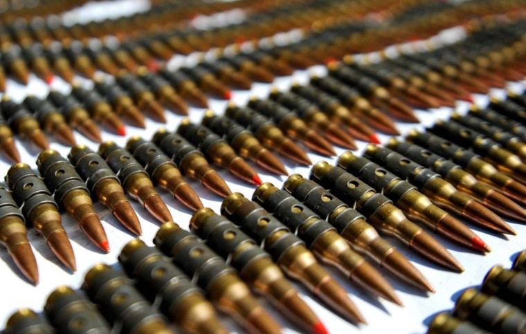 Seized machine gun ammo belts are displayed on December 10, 2012, in Cali, Valle del Cauca department, Colombia. Colombia's army found a cove that contained twelve 5.56mm caliber rifle, a 7.62mm machine gun, a grenade launcher, 66 kilograms of explosives, 40 grenades, and some 3000 cartridges, allegedly belonging to the Revolutionary Armed Forces of Colombia (FARC) guerrillas. (Luis Robayo/AFP/Getty Images)