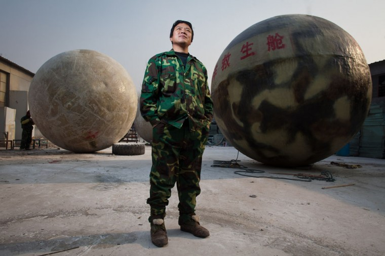 Farmer Liu Qiyuan poses among survival pods that he built and has also dubbed 'Noah's Arc,' in a yard at his home in the village of Qiantun, Hebei province, south of Beijing. Inspired by the apocalyptic Hollywood movie '2012' and the 2004 Asian tsunami, Liu hopes that his creations consisting of a fibreglass shell around a steel frame will be adopted by government departments and international organisations for use in the event of tsunamis and earthquakes. Liu has built seven pods which are able to float on water, some of which have their own propulsion. (Ed JonesEd Jones/AFP/Getty Images)