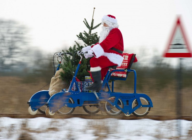 Santa Claus rides with Christmas presents in Mellensee, eastern Germany. (Patrick Pleul/Getty Images)