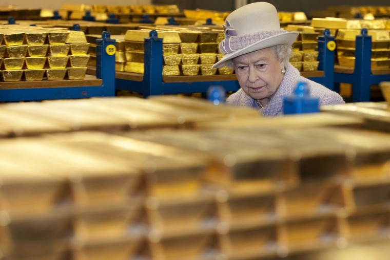 Queen Elizabeth II inspects gold reserves in a vault at the Bank of England in London. (Eddie Mulholland/Getty Images)