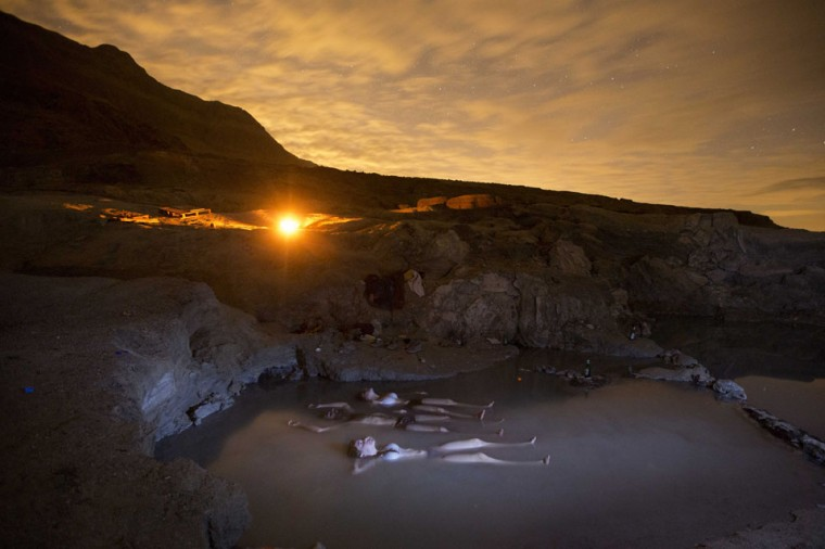 Israelis float in a hot water spring on the shore of the Dead Sea near the Israeli Kibbutz of Ein Gedi as they watch the sky looking for Geminid meteors streaks above the Judean desert early December 14, 2012. (Menahem Kahana/AFP/Getty Images)