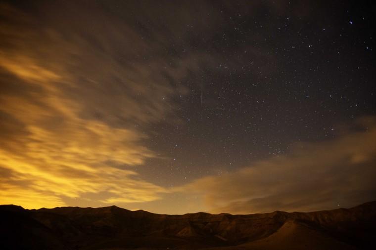 A Geminid meteor streaks are seen above the Judean desert near near the Israeli Kibbutz of Ein Gedi early December 14, 2012. (Menahem Kahana/AFP/Getty Images)