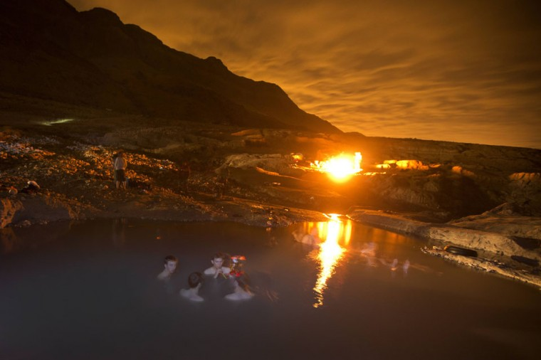 Israelis enjoy a a hot water spring on the shore of the Dead Sea near the Israeli Kibbutz of Ein Gedi as they watch the sky looking for Geminid meteors streaks above the Judean desert early December 14, 2012. (Menahem Kahana/AFP/Getty Images)