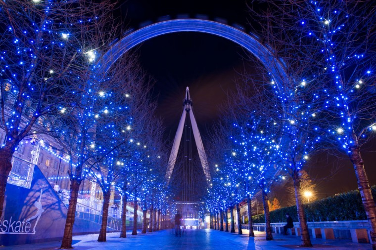 Christmas decorations in the trees light up the path leading towards the London Eye in central London. Areas of the city are illuminated with festive lights as the British capital gears up for the holiday season. (Leon Neal/AFP/Getty Images)