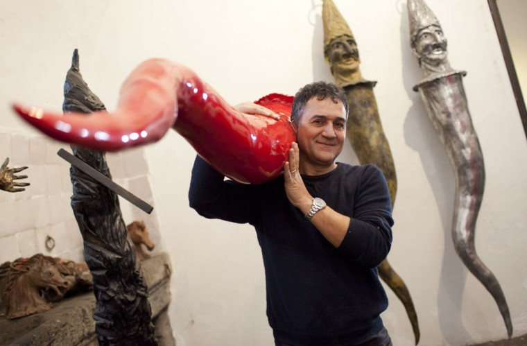 Italian artist Lello Esposito shows his 2.70-meters lucky horns in his atelier in Naples on December 15, 2012. These giant horns, larger versions of what many southern Italians believe to be a symbol of good luck, were created by Esposito to prevent the end of the world forecasted on December 21, 2012. (Carlo Hermann/AFP/Getty Images)