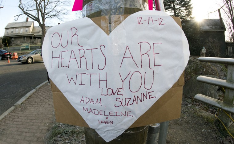 A sign honoring the victims of the Sandy Hook Elementary School shooting is seen on a telephone pole in the business area of Newtown, Connecticut. The residents of the idyllic Connecticut town were reeling infrom the massacre of 20 small in the second deadliest school shooting in U.S. history. (Don Emmert/AFP/Getty Images)