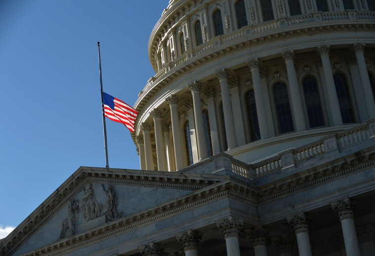A U.S. flag flies at half-staff above the U.S. Capitol in Washington, D.C., to mourn the victims of the Sandy Hook Elementary School shooting in Newtown, Conn. (Mandel Ngan/AFP/Getty Images)